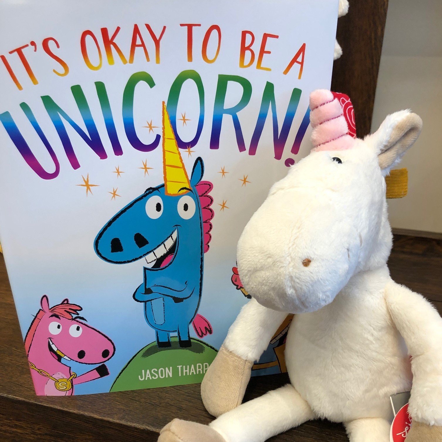 unicorn book with stuffed unicorn